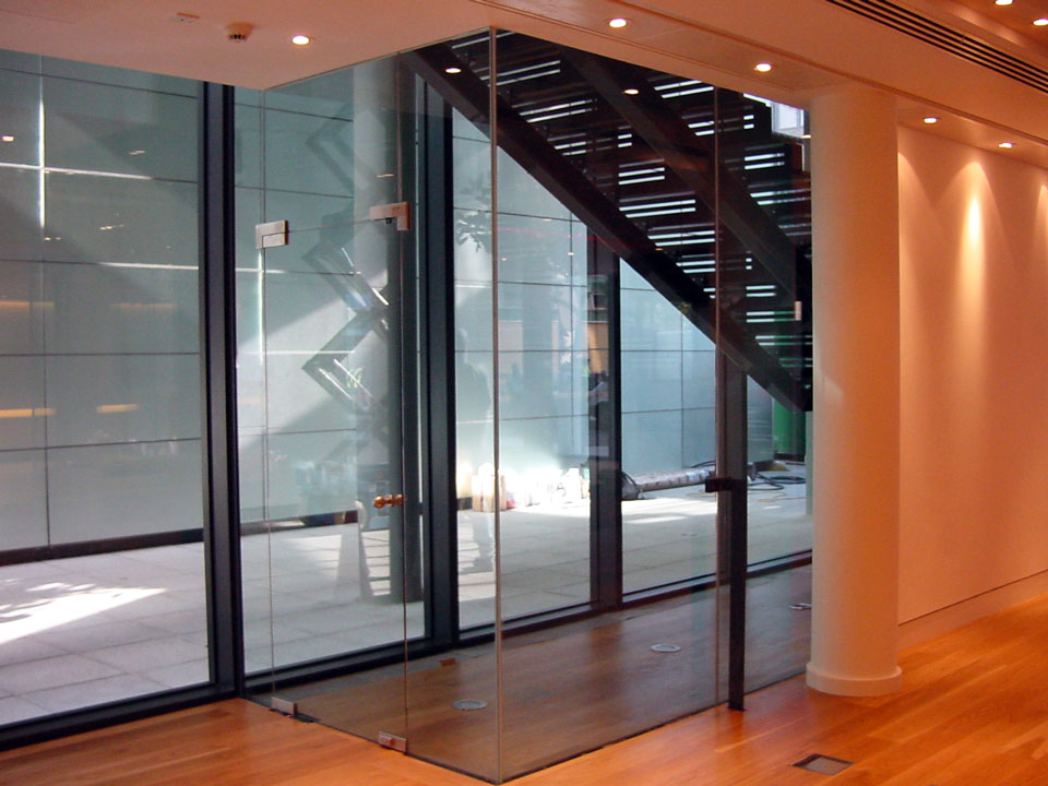 Single glazed frameless pivot glass doors for Glass wall door systems